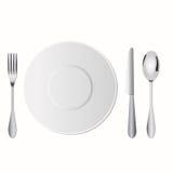 La messa a punto del piatto sulla tavola include la forchetta, il cucchiaio ed il coltello Fotografia Stock Libera da Diritti