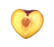 La metà della prugna ha modellato come cuore Fotografia Stock Libera da Diritti