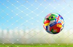 La meta del fútbol con el balón de fútbol con las banderas del mundo diseña en el fútbol n stock de ilustración