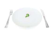 La mia dieta, broccolo su una zolla bianca Immagine Stock