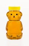 La miel en un envase de plástico formó como un oso. Imagen de archivo