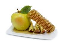 La miel y la manzana son símbolos del hashanah del rosh Imagen de archivo