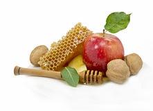 La miel y la manzana son símbolos del hashanah del rosh Foto de archivo libre de regalías
