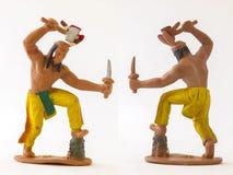 La mini figura juguete del vaquero indio del modelo/aisló blanco Imagenes de archivo