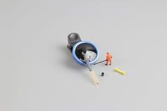 la mini macchina fotografica di pulizia del lavoratore della gente len Immagine Stock Libera da Diritti