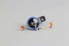 la mini macchina fotografica di pulizia del lavoratore della gente len Immagini Stock Libere da Diritti