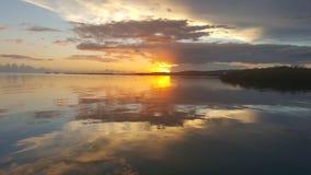 La mitad bloqueó puesta del sol Fotos de archivo