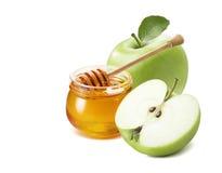 La mitad verde y la miel de la manzana sacuden por Año Nuevo judío Foto de archivo libre de regalías