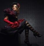 La mode a tiré de la femme dans le type de poupée Photographie stock libre de droits