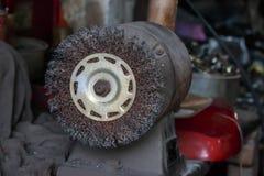 La molatura e brunire spingono gli usi per la molatura e la pulizia me Fotografia Stock