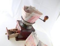 La molatura martella nei penny Fotografie Stock