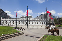 La Moneda Palace, Santiago de Chile. Wide angle view of mounted guards protecting La Moneda Palace, Santiago de Chile Royalty Free Stock Photos