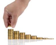 La moneta fa scorrere su un fondo bianco Fotografia Stock Libera da Diritti