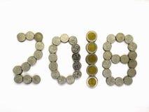 La moneta tailandese isolata sui precedenti bianchi Fotografia Stock