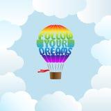 La mongolfiera con le parole segue i vostri sogni Fotografia Stock Libera da Diritti