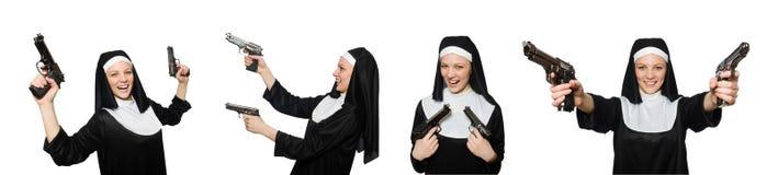 La monja con la arma de mano aislada en blanco Foto de archivo libre de regalías