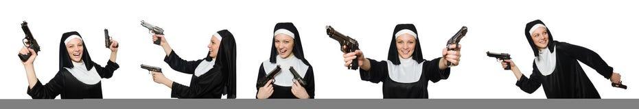 La monja con la arma de mano aislada en blanco Fotos de archivo
