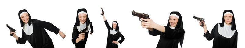 La monja con la arma de mano aislada en blanco Fotografía de archivo libre de regalías