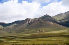 La montagne de la lumière et de l'ombre tissant au Thibet Images libres de droits