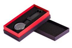 La montre noire dans une boîte photographie stock