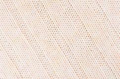 La morbidezza beige ha tricottato la struttura del tessuto con il wale delle strisce immagine stock