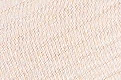 La morbidezza beige ha tricottato la struttura del tessuto con il wale delle strisce Fotografia Stock Libera da Diritti