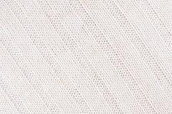 La morbidezza bianca ha tricottato la struttura del tessuto con il wale delle strisce Immagini Stock
