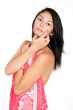 La morenita bonita pone la crema en cara Foto de archivo libre de regalías