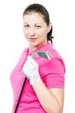 la morenita linda tiene una afición que juega al golf, retrato en un blanco Foto de archivo libre de regalías
