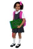 La muñeca bonita está lista para la escuela Foto de archivo libre de regalías