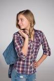 La muchacha adolescente adorable mira detrás Imagen de archivo libre de regalías
