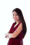 La muchacha adolescente biracial hermosa en brazos derechos del vestido rojo cruzó, Foto de archivo libre de regalías