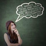 La muchacha adolescente dice otro idioma Fotografía de archivo
