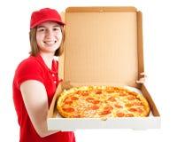 La muchacha adolescente entrega la pizza Foto de archivo libre de regalías