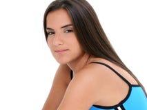 La muchacha adolescente hermosa en azul resuelve la ropa Foto de archivo libre de regalías
