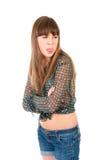 La muchacha adolescente ofendida muestra su lengüeta Foto de archivo libre de regalías