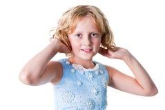 La muchacha adolescente se viste para arriba para el partido aislado en blanco Imagen de archivo libre de regalías