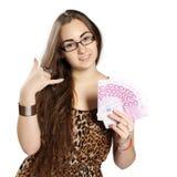La muchacha adolescente sostiene el dinero en una fan-forma Fotografía de archivo
