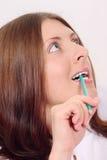 La muchacha agradable con un lápiz Imagen de archivo libre de regalías