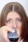 La muchacha agradable con un panel de control  Foto de archivo