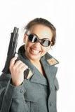 La muchacha alegre con un arma Foto de archivo libre de regalías