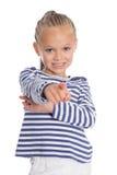 La muchacha alegre señala un finger adelante Fotos de archivo