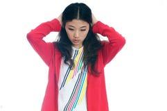 La muchacha asiática infeliz triste adentro descree Imagenes de archivo