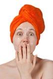 La muchacha asustada con crema anti-akne en la cara Fotos de archivo libres de regalías
