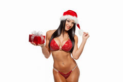 La muchacha atractiva hermosa que lleva a Papá Noel viste con la Navidad g Fotos de archivo