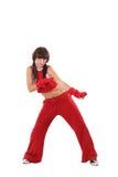 La muchacha baila en un juego rojo Fotografía de archivo