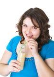 La muchacha bebe una bebida de la lechería Fotos de archivo