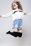 La muchacha bonita está saltando Fotografía de archivo libre de regalías