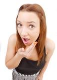 La muchacha bonita hace una mueca en su cara. Imágenes de archivo libres de regalías