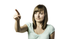 La muchacha bonita muestra un finger en algo Fotos de archivo libres de regalías